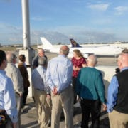 Christine Boldt talking to the Trustees at the Miami International Airport.